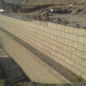 Slope stabilization works with Reinforced soil wall system for South Toll plaza